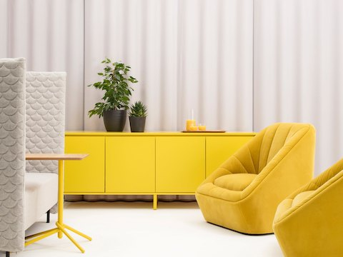 A yellow naughtone Sideboard Storage in the background of a grey Cloud Quilt Sofa, a yellow Knot Side Table and two yellow Fiji Chairs.
