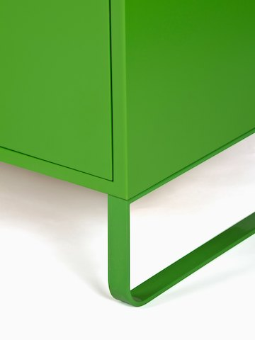 A close-up view of a green naughtone Sideboard Storage base.