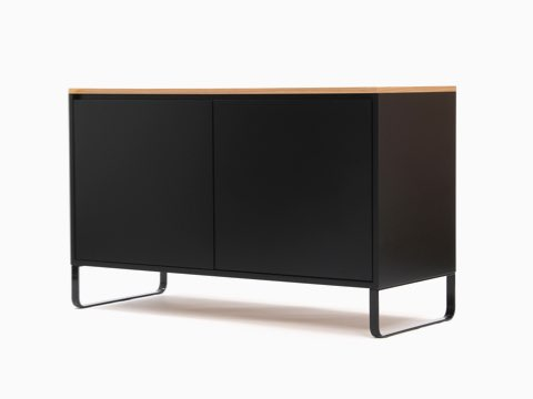 An all-black naughtone Sideboard Storage with an oak veneer top, viewed at an angle.