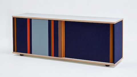 A navy Softbox Storage Credenza with colorful stripes fully closed, viewed at an angle.