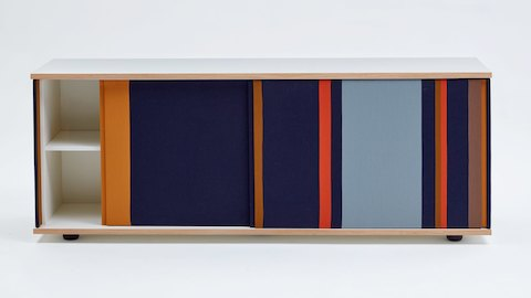 An empty navy Softbox Storage Credenza with colorful stripes opened partially, viewed from the front.