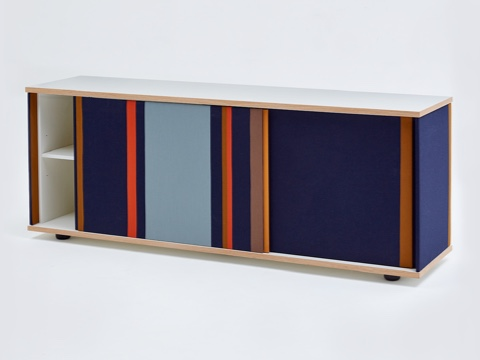 A navy Softbox Storage Credenza with colorful stripes opened partially, viewed at an angle.