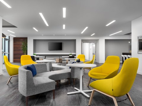 Gray single naughtone Symbol Benches joining Symbol Modular Seating together to snake across the room with yellow Always Lounge Chairs.