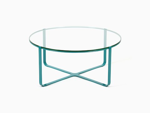 A blue, round Trace Coffee Table with glass top, viewed from the front.