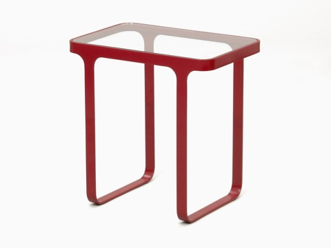 A red naughtone Trace Side Table with glass top, viewed at an angle.