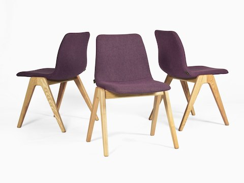 Three identical purple naughtone Viv Wood Chairs placed with their backs towards one another, facing different directions.
