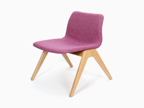 A pink naughtone Viv Wood Lounge Chair, viewed at an angle.