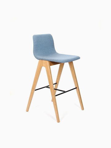 A blue upholstered naughtone Viv Wood Stool, viewed at an angle.