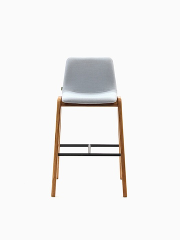 A light gray upholstered naughtone Viv Wood Stool, viewed from the front.
