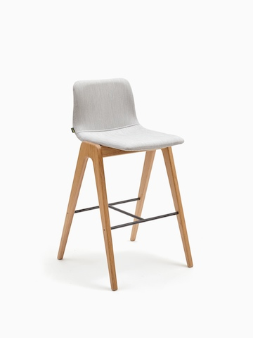 A light grey upholstered naughtone Viv Wood Stool, viewed at an angle.
