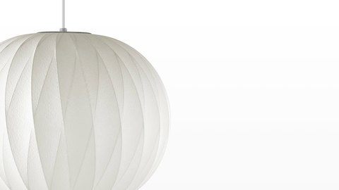 Close view of the Nelson Ball CrissCross Bubble Pendant white hanging lamp.