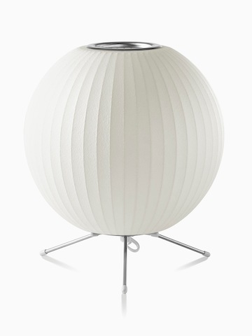 A white table lamp. Select to go to the Nelson Ball Tripod Lamp product page.