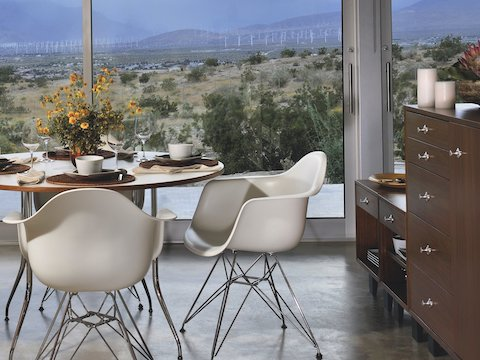 Nelson Basic Cabinet Series modular storage pieces join Eames Molded Plastic Chairs in a dining area overlooking the desert.