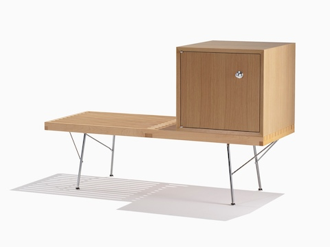 A Nelson Basic Cabinet Series closed storage module sits atop a Nelson Platform Bench, both with light finishes.
