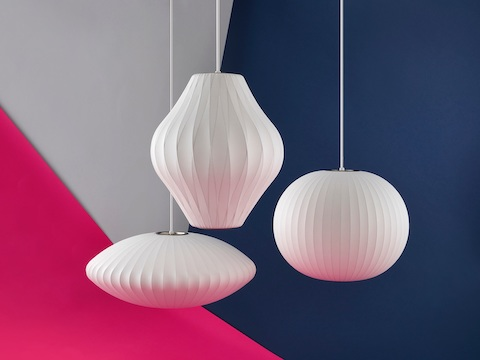 Three hanging Nelson Bubble pendant lamps.
