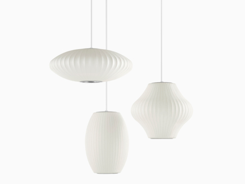 Three white pendant Nelson Bubble Lamp lights.