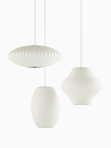 Three white Pendant lamps. Select to go to the Nelson Bubble Lamps product page.