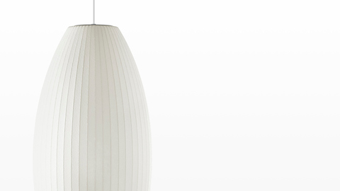 Close view of the shade on a medium Nelson Cigar Bubble Pendant white hanging lamp.