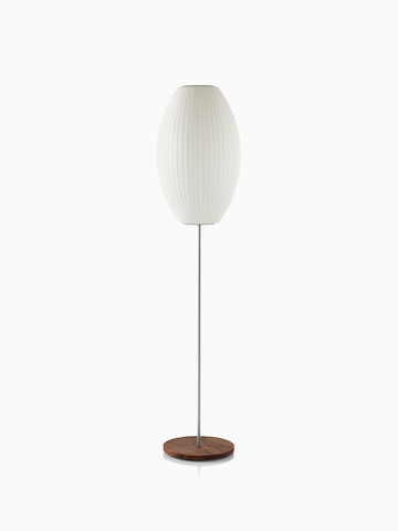 A white Nelson Cigar Lotus Floor Lamp with a medium shade and a walnut-covered steel base.