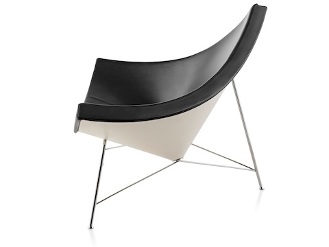 Profile view of a black leather Nelson Coconut Lounge Chair.