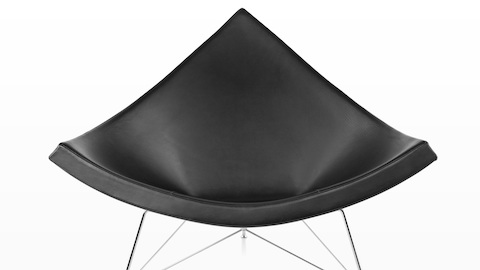 Close view of a black leather Nelson Coconut Lounge Chair, highlighting its resemblance to a chunk of coconut.