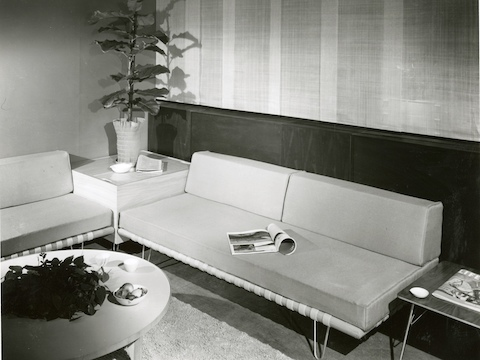 A vintage black-and-white photo of two Nelson Daybeds used as sofas in an office lobby.