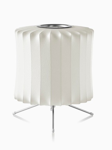 A white table lamp. Select to go to the Nelson Lantern Tripod Lamp product page.