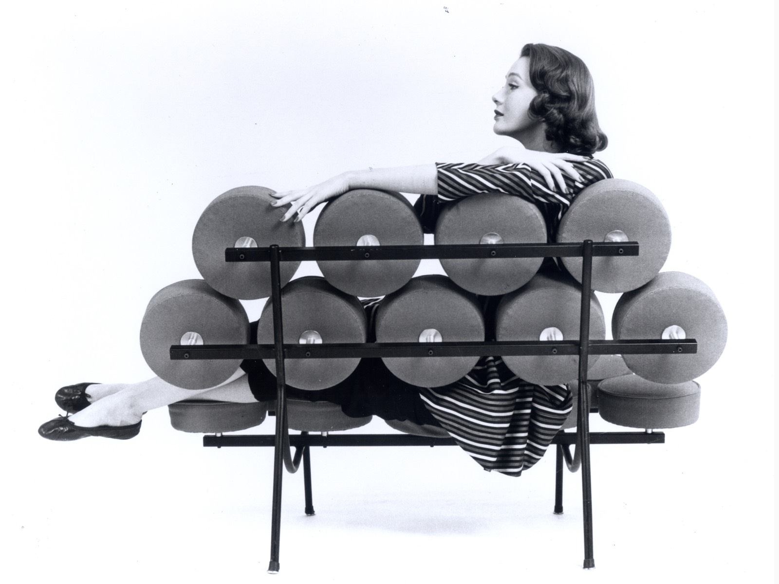 A Vintage Black And White Photo Of Woman With Her Feet Up On