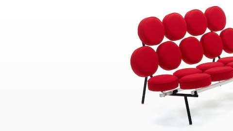 A Nelson Marshmallow Sofa upholstered in red fabric, viewed from a 45-degree angle.