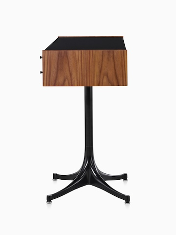 Side view of a horizontal Nelson Miniature Chest with a medium finish, black top, and black pedestal base.