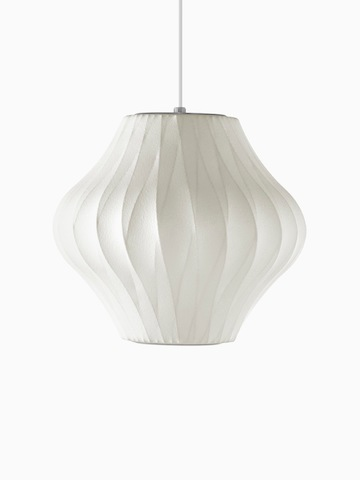 A white hanging lamp. Select to go to the Nelson Pear CrissCross Bubble Pendant product page.
