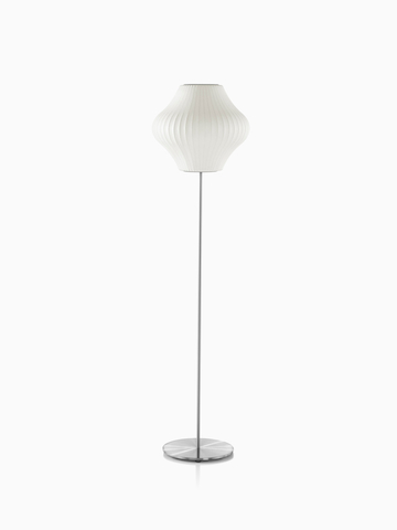 A white Nelson Pear Lotus Floor Lamp with a steel base and the smaller of two available shades.