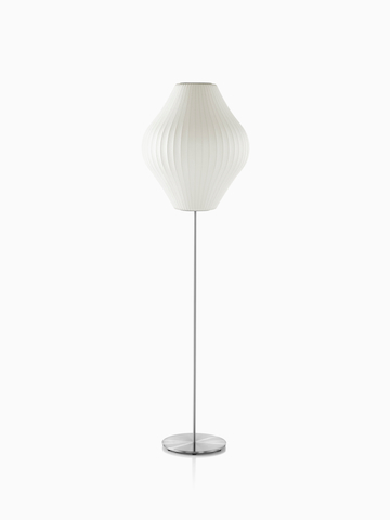 A white Nelson Pear Lotus Floor Lamp with a steel base and the larger of two available shades.