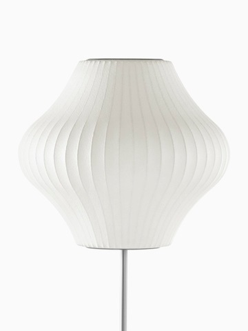 A white floor lamp. Select to go to the Nelson Pear Lotus Floor Lamp product page.