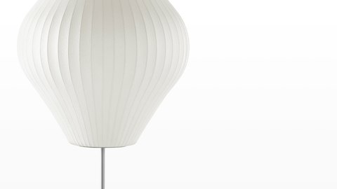 Close view of the white shade on a Nelson Pear Lotus Floor Lamp.