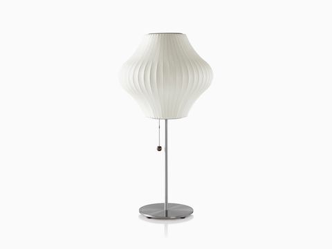 A white Nelson Pear Lotus Table Lamp with a steel base.