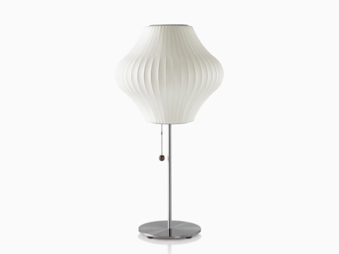 A white Nelson Pear Lotus Table Lamp.