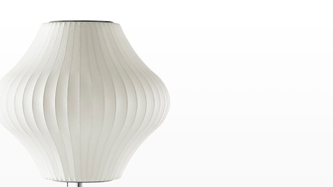 Close view of the white shade on a Nelson Pear Lotus Table Lamp.