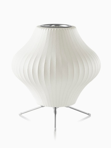 A white table lamp. Select to go to the Nelson Pear Tripod Lamp product page.