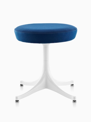 Nelson Pedestal Stool with a blue upholstered seat and white base.