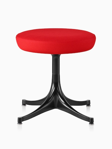 Nelson Pedestal Stool with a red upholstered seat and black base.