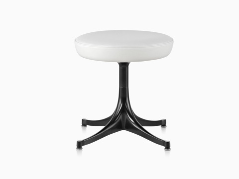 Nelson Pedestal Stool with a white leather seat and black base.