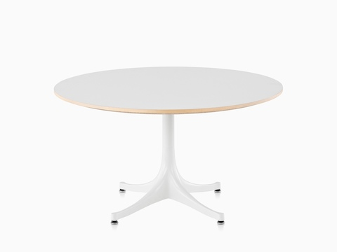 A round Nelson Pedestal Table with a white laminate top and white base.