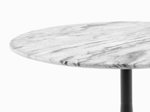 Close view of the white marble top on a round Nelson Pedestal outdoor table.