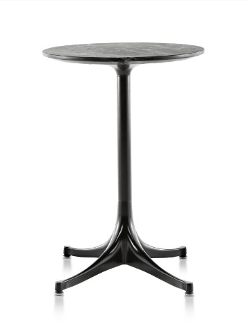 A round Nelson Pedestal outdoor side table with a black stone top and black base.