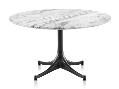 A round Nelson Pedestal outdoor coffee table with a white marble top and black base.