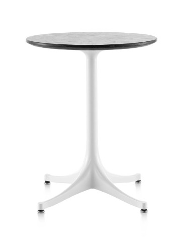 A round Nelson Pedestal outdoor side table with a black stone top and white base.
