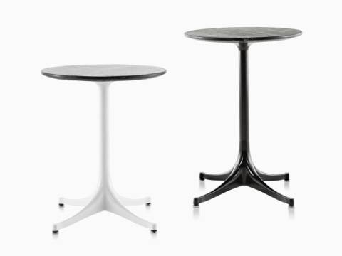 Two round Nelson Pedestal outdoor side tables with black stone tops, one with a white base and one with a black base.