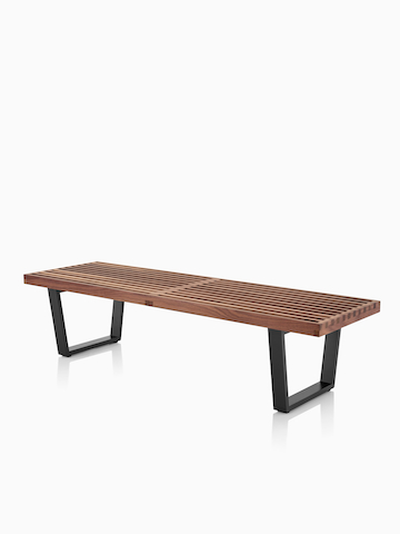 A Nelson Platform Bench with a medium wood finish. Select to go to the Nelson Platform Bench product page.