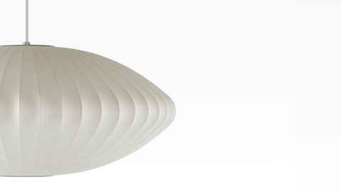 Partial view of a Nelson Saucer Bubble white pendant lamp.